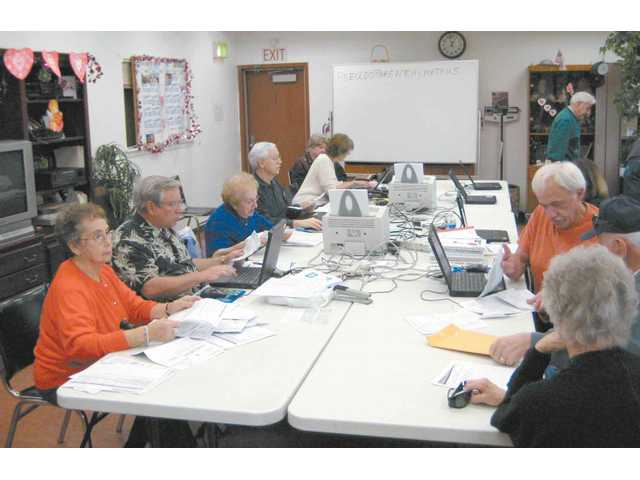Seniors organize and e-file their income tax returns.