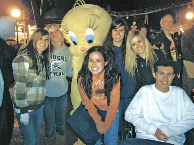 From left to right,  Lauren Dyer, Abby Linn, Krissy Allegra, Jaeger Woodson, Jessica Breneman and Colton Jackson pose with Tweety Bird.  Young Life recently celebrated 25 years as a faith-based organization Thursday.