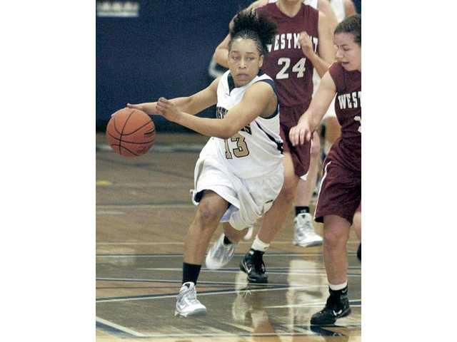 The Master's College point guard Erica Inge (13) drives down the court against Westmont on Feb. 13. Inge has successfully adapted her game on a couple of occasions to excel in the Mustangs' system.