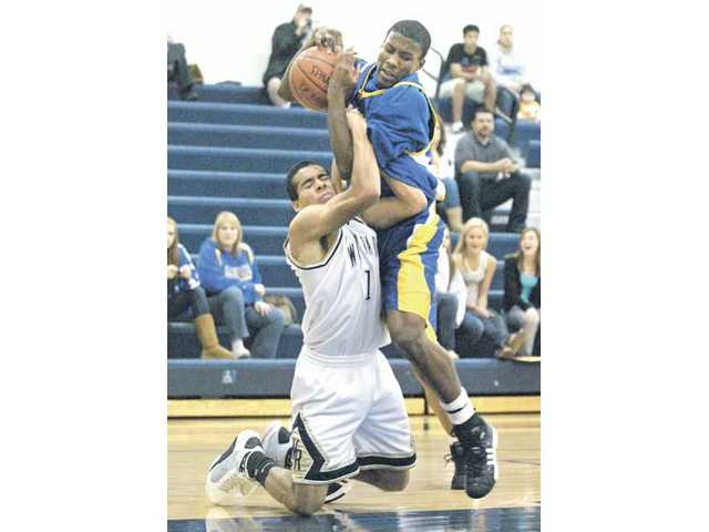 West Ranch's Alejandro Castro (left) tries to steal the ball from Valencia of Placentia's Christian Mack Friday during the CIF-SS Div. IIAA playoffs at West Ranch High School.