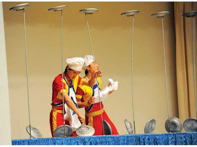 Two of the performers balanced several plates on top of poles, keeping the plates spinning the whole time.