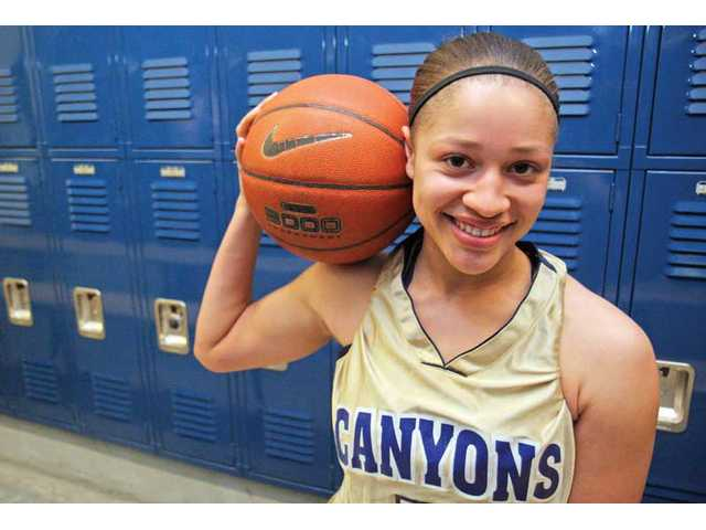 College of the Canyons point guard Kelli Lewis suffered three different ACL injuries during her career at Hart High School. But after redshirting a year at COC, the tenacious Lewis is well on her way to becoming the Cougars' latest star point guard.