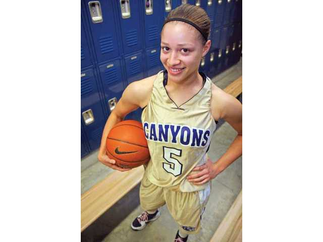 Hart High graduate and College of the Canyons point guard Kelli Lewis has battled back from three ACL injuries to star for the Cougars.