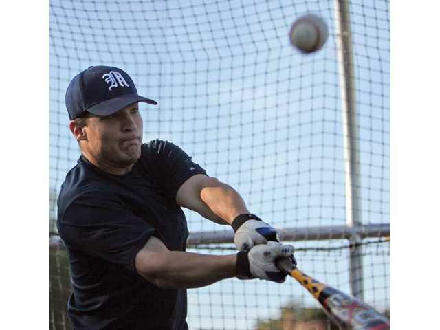 The Master's College catcher Chris Talley takes batting practice earlier this season. Talley has provided the team with an unexpected offensive punch.
