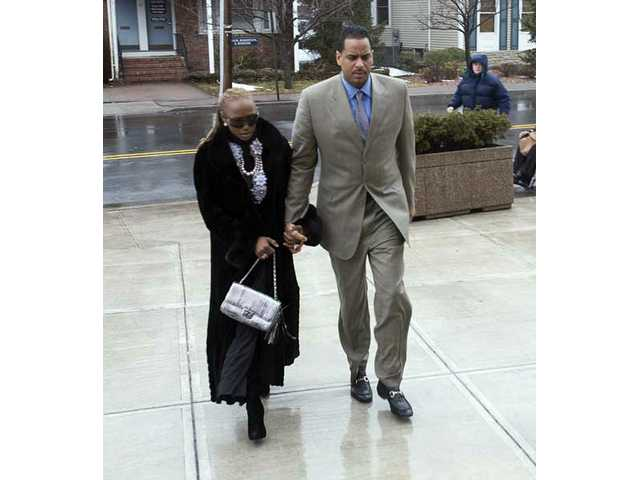 "Former NBA star Jayson Williams and wife Tanya Young Williams arrive at the Somerville, NJ courthouse on Feb. 23, 2010 for Jayson's sentencing in the 2002 fatal shooting of Costas ""Gus"" Christofi. Superior Court Judge Edward Coleman sentenced Williams to five years in prison with a minimum of 18 months before he is eligible for parole."