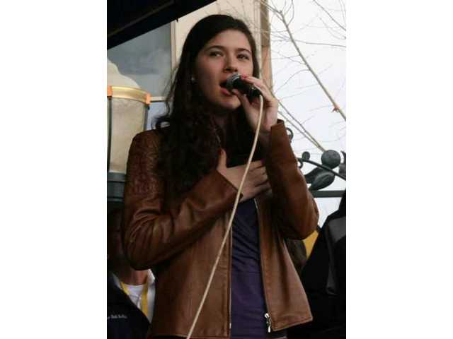 Sara Neimietz, a sophomore at Saugus High School, sang the national anthem at Valencia Town Center Sunday at the opening ceremonies for Stage 7 of the Amgen Tour of California cycle race.
