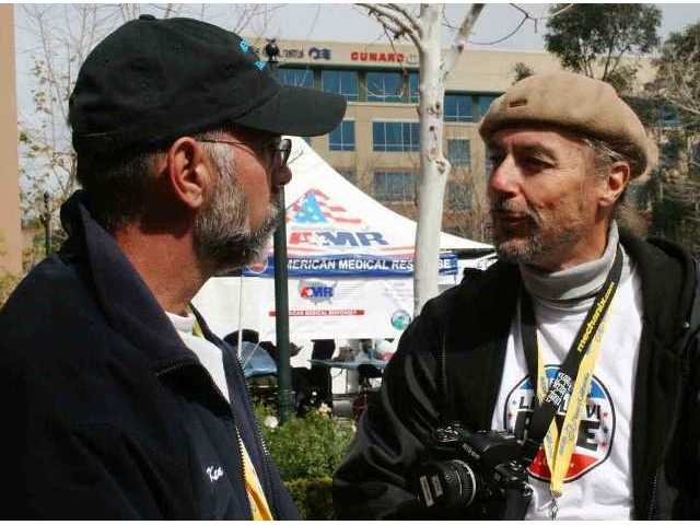 Ken Pulskamp, Santa Clarita City Manager, and Tom Barron, president of the Santa Clarita Velo cycle club, talk Sunday afternoon after the Tour of California cyclists have started racing toward Pasadena.