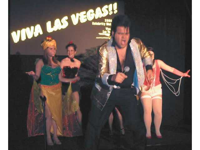 "Good times were had and good money was raised for a good cause at the annual Celebrity Waiter Dinner held at the Valencia Hyatt Friday night to benefit the Respite Adult Day Care at the SCV Senior Center. George Chavez, backed by Canyon Theatre Guild dancers, sings ""Viva Las Vegas."""