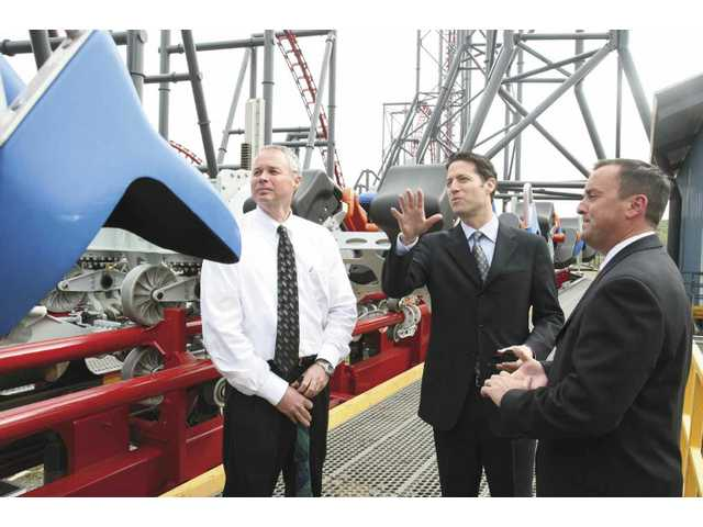 From left, General Manager Tim Burkhart, Six Flags CEO Mark Shapiro, and park President Jay Thomas survey one of the three new racks of cars for the X2 ride, which underwent approximately $10 million in upgrades.