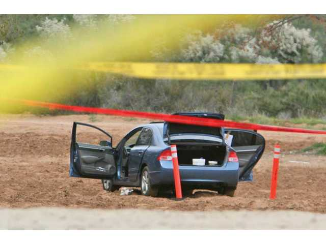 The body of a woman whose identify had not been released at press time was found in a car Tuesday morning near Lake Hughes Road. The woman apparently committed suicide using a mixture of chemicals that created a toxic gas, according to authorities.