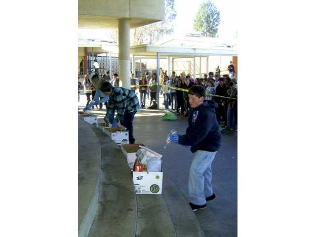 Sierra Vista Junior High School students participate in recycling on campus as part of the Go Green Week organized by the school's yearbook staff.