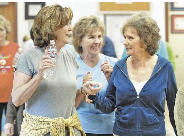 Workout attendees, from left, Pat Riner, Marge McKenna and Marilyn Rainey, enjoy each other's company as they walk a lap around the workout room at the Santa Clarita Valley Senior Center Wednesday.