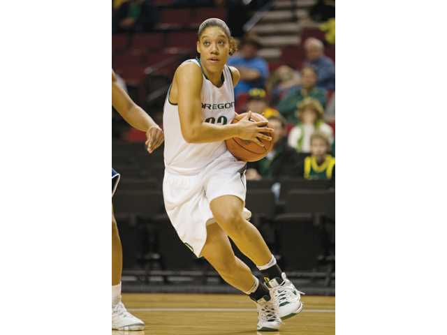 In this undated photo, Oregon wing and former Hart High School standout Tatianna Thomas takes the ball to the hoop.