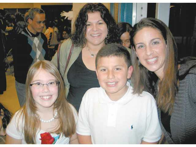 """From left, Margo Tannewitz, third grade teacher Linda Valdes, her son Josh Valdes, and fourth grade teacher Christine Gonzales are all smiles during the """"Character Counts"""" program at Rio Vista Elementary School."""