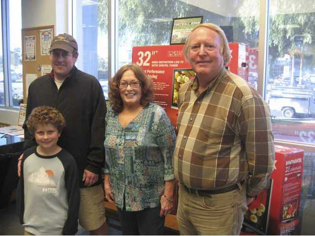 "Mike Pontius and his son Ryan, Judie Pieper and Jerry Sheggud visited The Signal's offices to pick up the Magnavox HDTV sets they won in The-Signal.com's ""U-Pick'Em Football 2008"" contest."