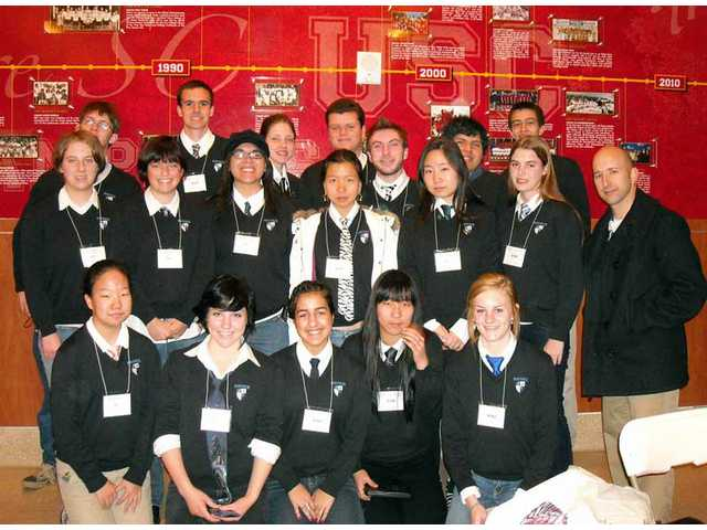 Saugus Academic Decathlon team and director Vilo Del Rio. The Saugus team placed higher than any other in the William S. Hart Union High School district.