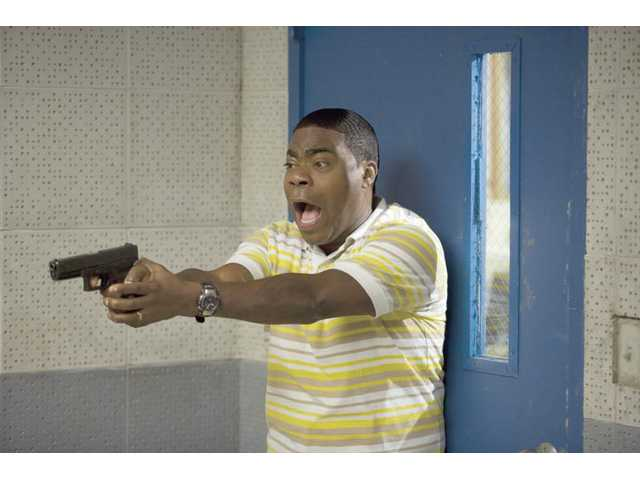 "Tracy Morgan is shown in a scene from, ""Cop Out."" It offers lame dialogue and humor fit for a third grader."