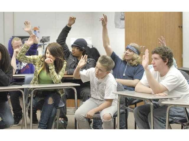 Cary Quashen asks individual teens to discuss drug-abuse issues during an Action meeting at Saugus High School Tuesday.