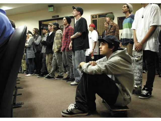 Sagan Lockhart, 20, of Saugus, listens to his fellow skateboarders speak to the City Council on Tuesday night. The skateboarders opposed the possible summer closure of the skate park, which they said would leave them with no place to skate.