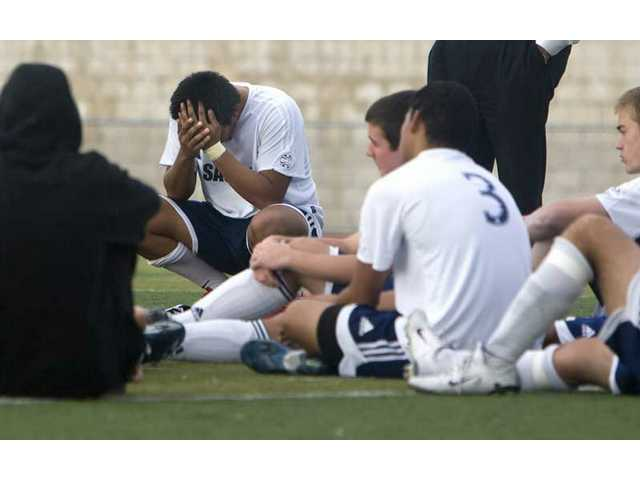 Saugus' D.J. Valladares shows his disappointment after a 4-0 loss to Coachella Valley in the CIF-Southern Section Division III playoffs Wednesday at Saugus.
