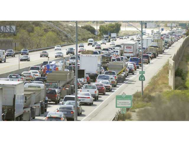 All jammed up after big rig flips on freeway