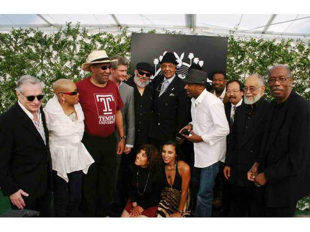 Pictured at the Playboy Mansion for the unveiling of the artist lineup for the 30th annual Playboy Jazz Festival in June are (standing, from left): Hugh Hefner, Dee Dee Bridgewater, Bill Cosby, Michael Lington, Poncho Sanchez, Ernie Andrews, Marcus Miller, Ndugu Chancler, Dan Taguchi, David T. Walker and Jerry Peters. In front are Raya Yarbrough (left) and Jessy J.