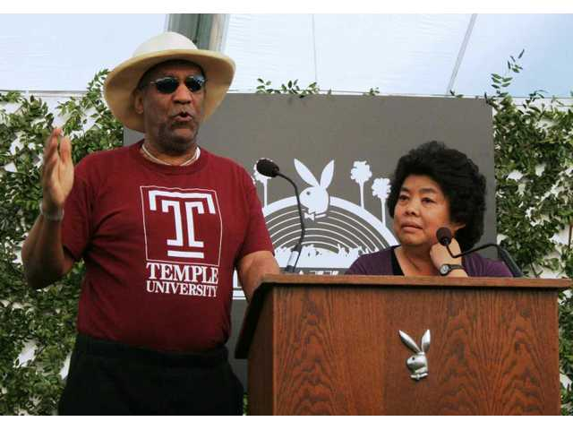 Bill Cosby and Darlene Chan riff their way through announcing the talent lineup for the 30th anniversary Playboy Jazz Festival in June.