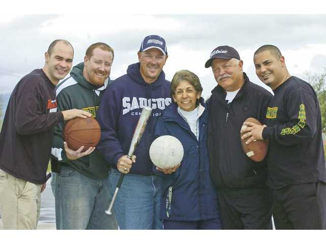 (From left) Hart girls basketball head coach Zach Koebel, Canyon boys basketball head coach Chad Phillips, Saugus athletic director Kevin Miner, West Ranch athletic director Dody Garcia, Hart golf coach Pete Calzia and Canyon athletic director Rich Gutierrez are still very active in prep sports in the Santa Clarita Valley after playing at local high schools themselves.