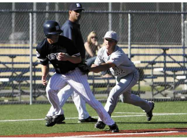 Pete Goeman, left, of The Master's College gets caught in a rundown in the fourth inning. He is tagged out by Jordan Bottenfield of Westmont, a Valencia High graduate. The Mustangs lost 7-4 at home on Wednesday.