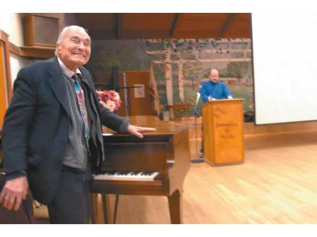 Bob Mitchell stands and acknowledges the applause of the enthusiastic crowd present at the SCV Senior Center on Sunday.