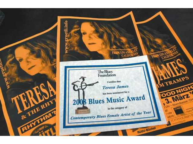 Handbills for Teresa James and The Rhythm Tramps back the certificate of nomination of James as the Blues Foundation's Contemporary Blues Female Artist of the Year. You can vote online for her through Feb. 29. The award will be presented on May 8 at the Grand Casino Event Center in Tunica Resorts, Miss.