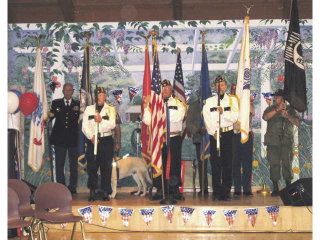 An Honor Guard made up of veterans from the American Legion Post #507 and the Vietnam Veterans of America Chapter 355 open an event dedicated to veterans at the Santa Clarita Valley Senior Center.