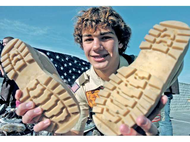 "For his Eagle Scout project, Boy Scout Andrew Aubrey, 15, of Troop 581 spearheaded a ""Soles 4 Souls"" shoe drive for Haiti's earthquake victims."