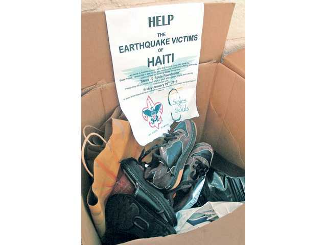 A donation box with shoes and a flyer for the donation drive sits in the parking lot of the Church of Jesus Christ Latter Day Saints in Saugus.
