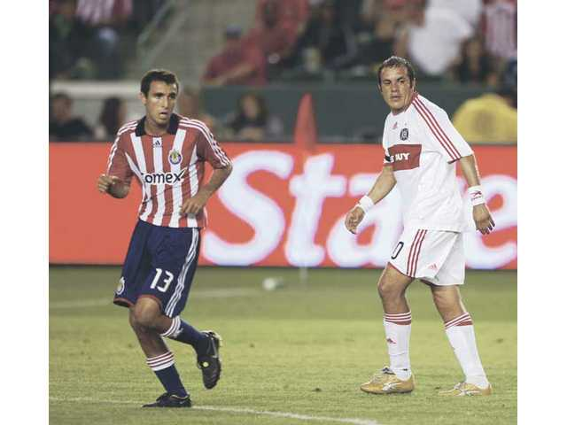 Chivas USA's Jonathan Bornstein defends Chicago Fire's Cuauhtemoc Blanco in this undate photo.  For Bornstein, the Hoefflin Foundation's goals hit close to home.