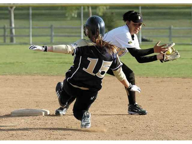 Breanne Lendman (15) of West Ranch slides into second base  Saturday at Central Park.