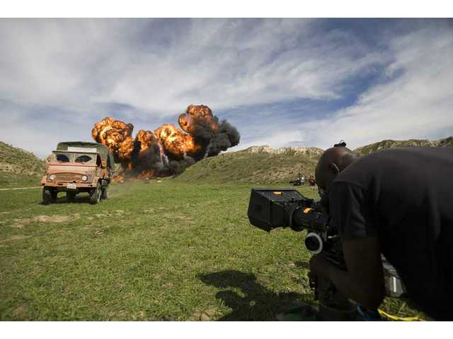 "An exploding opening sequence for an episode of the TV show ""The Unit"" takes place on Pico Canyon Road north of Mentryville Tuesday afternoon. About 500 gallons of gasoline were used to create the explosion."