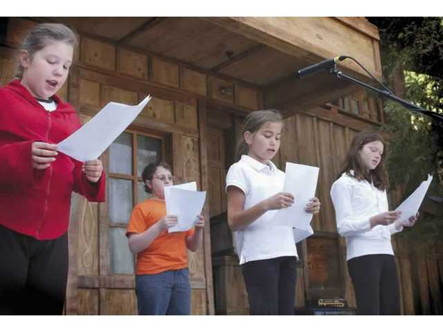 Beth Knesset Bamidbar's choir sings during the annual PurimFest at Magic Mountain.