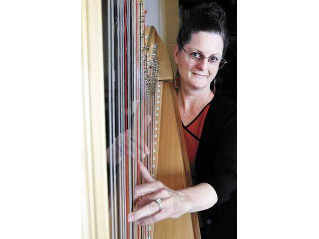 Marcy Pikop, an independent home study teacher, owns 51 harps and rents them to students. She has been in the business with her husband for 14 years.