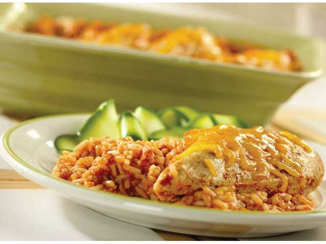Fiesta Chicken and Rice BakePrep: 5 minutesBake: 45 minutesMakes: 4 servings    1     can (10 3/4 ounces) Campbell's condensed tomato Soup    3/4     cup water*    3/4     cup uncooked regular long-grain white rice    1     teaspoon chili powder    4     skinless, boneless chicken breasts (about 1 pound)    1/4     cup shredded cheddar cheese1. Stir the soup, water, rice and chili powder in a 2-quart shallow baking dish. Place the chicken on the rice mixture. Sprinkle with additional chili powder, if desired. Cover the baking dish.2. Bake at 375°F for 45 minutes or until chicken is cooked through and the rice is tender. Sprinkle with the cheese.*For creamier rice, increase water to 1 1/3 cups.Cost per recipe: $5.65Cost per recipe serving: $1.41Nutritional values per serving: calories 356, total fat 6g, saturated fat 2g, cholesterol 81mg, sodium 422mg, total carbohydrate 41g, dietary fiber 1g, protein 32g, Vitamin A 11%DV, Vitamin C 7%DV, calcium 8%DV, iron 17%DV