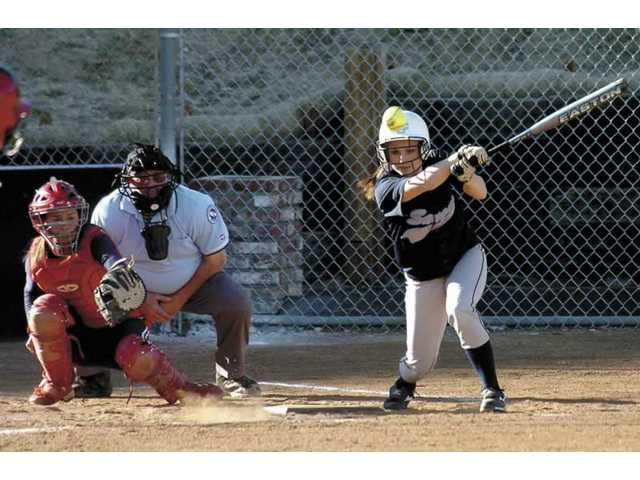 Saugus High's Nikki Dahner (44) comes up with a seventh-inning hit Monday against Lancaster at Saugus High. In Saugus' first home game in four years, it won 5-4.