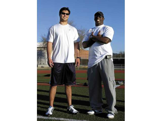 Carolina Panthers quarterback Matt Moore, left, and former University of Washington linebacker Dan Howell — both Hart High graduates — are represented by agent advisor Joe Alosi. The pair worked out Monday at Hart High.