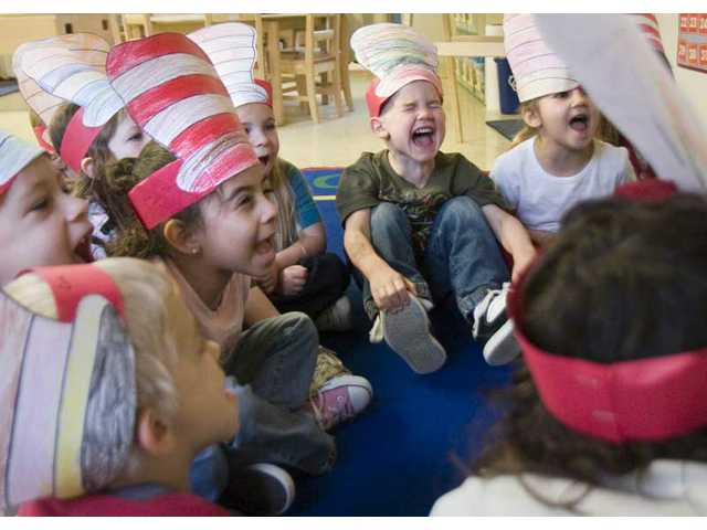 "La Petite Academy pre-kindergarten students recite ""Green Eggs and Ham"" Monday morning in celebration of Dr. Seuss' birthday. Theodore Geisel, who died in 1991, would have been 105 Monday. Geisel wrote the best-selling book ""Green Eggs and Ham"" in 1960."