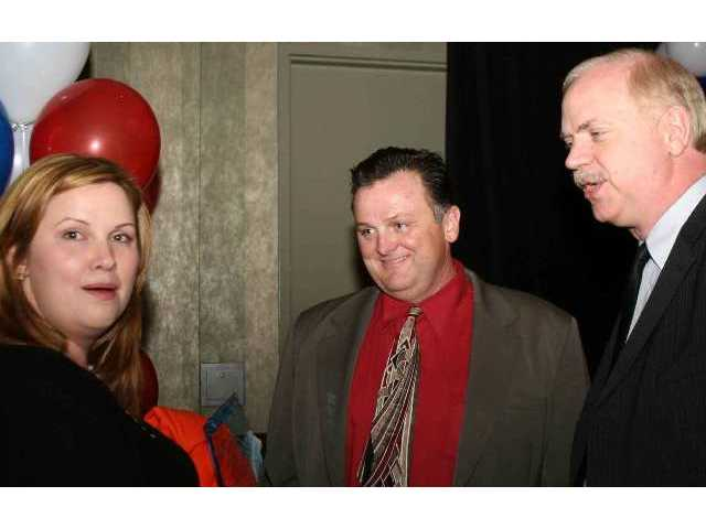 Community Service Newsmaker of 2007 Jeanna Crawford is congratulated by SCV Press Club chief Tim Whyte (center), Signal Publisher Jay Harn, and a pesky reporter with a camera.