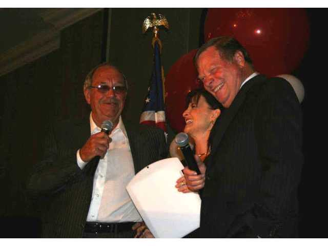 Don Fleming and Bob Kellar, with a lot of help from Barbara Myler, conduct a fundraising auction for the Randy Wicks Memorial Scholarship Fund at the 2007 Newsmaker Awards Friday night.
