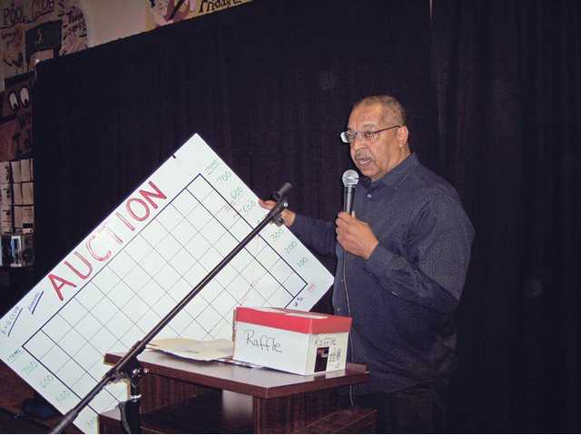 Jim Ventress, chief professional officer of the SCV Boys & Girls Club explains a chart showing auction item donations from the 2009 auction.