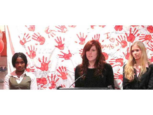 Julia Price, center, of Canyon High School, in New York as a North American delegate to participate in Red Hand Day at a United Nations presentation Feb. 12.