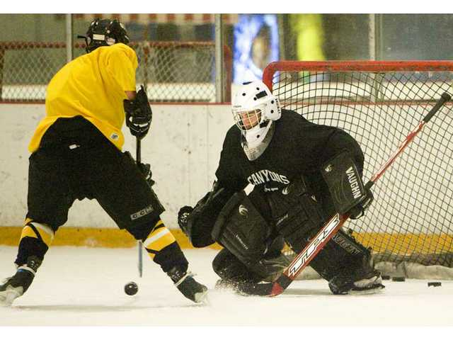 College of the Canyons goalie Michael McGrath, right,  prepares to stop a teammate from scoring in practice on Thursday at Ice Station Valencia.