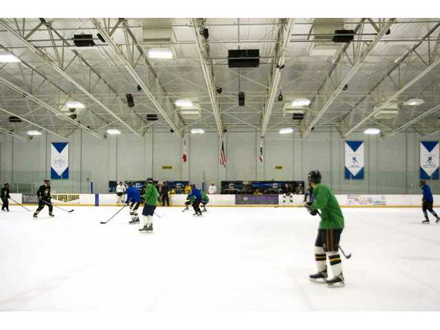 The College of the Canyons hockey team practices Thursday evening at Ice Station Valencia.