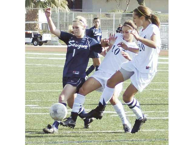 Saugus' Shasta Fisher (1) vies for the ball with Redlands' Kloey Glass (10) and Hannah Carroll (20) Tuesday during the CIF-Southern Section Division II semifinals in Redlands.